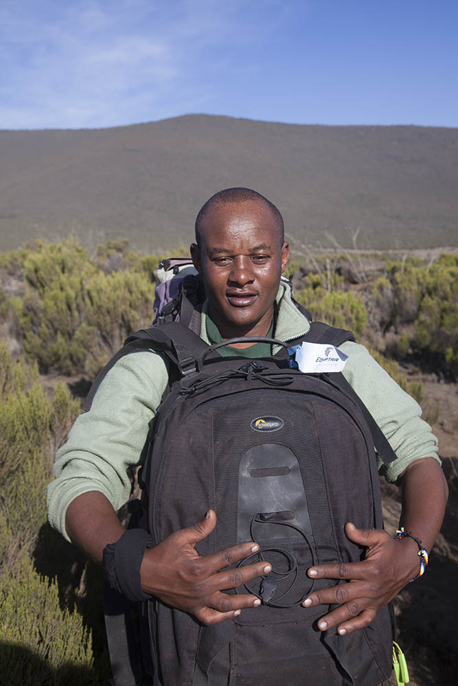 Isaac with my photographic back pack, Mt Kilimanjaro